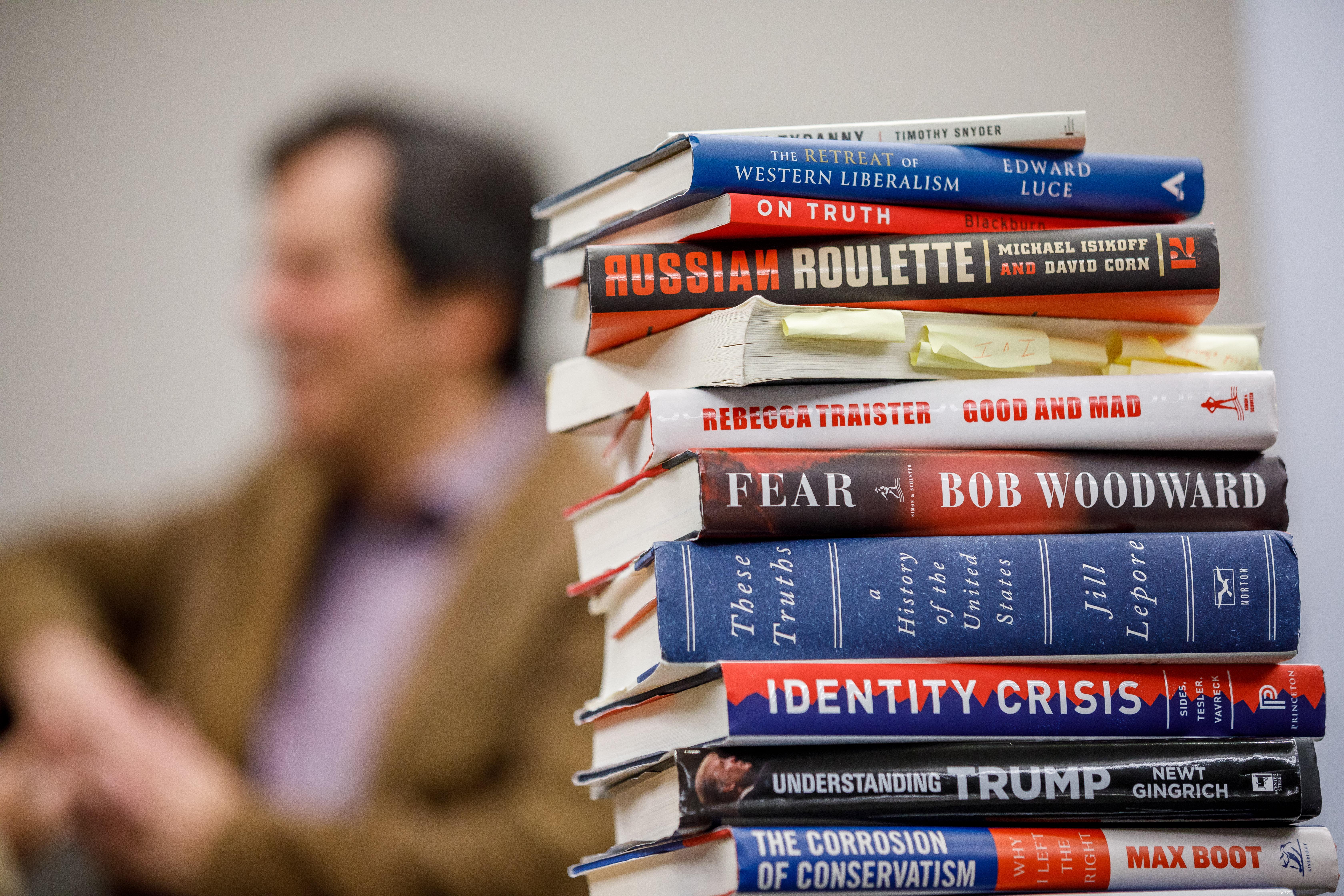 Carlos Lozada with books