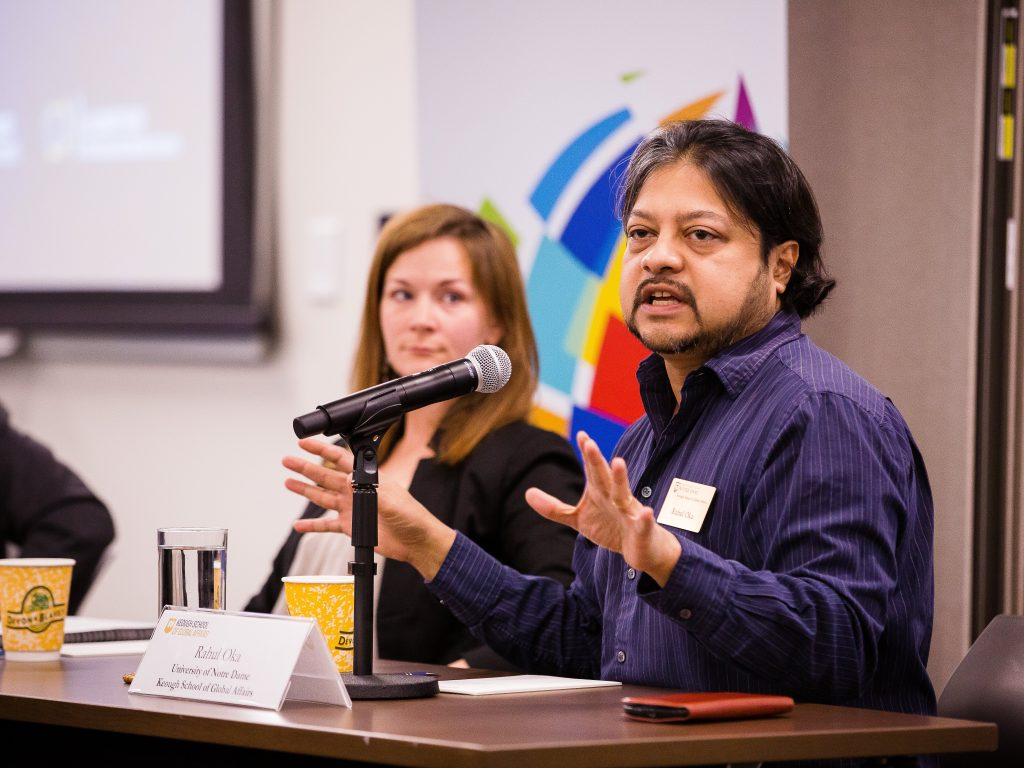 Professor Rahul Oka gestures to the audience while speaking at the South Asia Conference