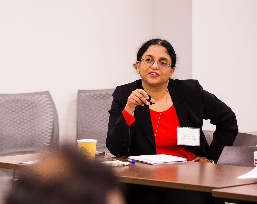 Professor Lakshmi Iyer discusses policy with the DC audience
