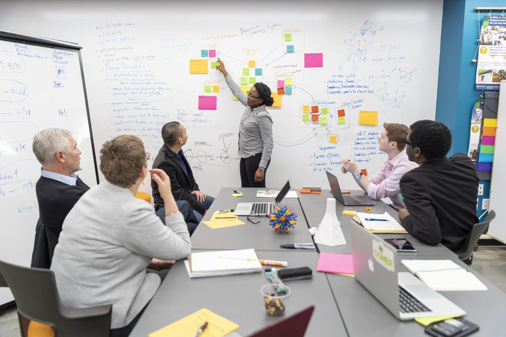 Patricia Ndagano leads a team meeting in the Keough School's i-Lab