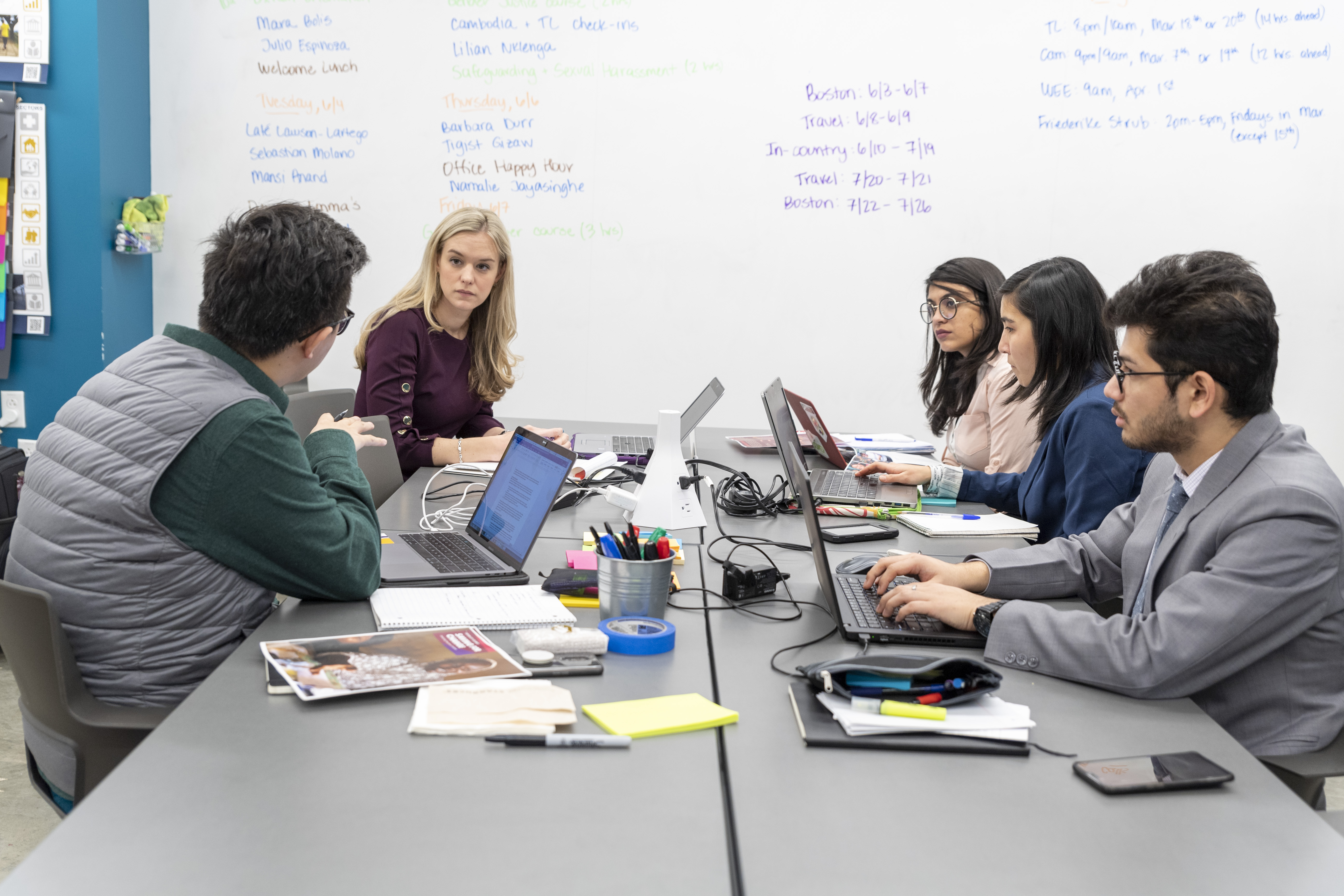 Emma Fawcett hosts a meeting with MGA students in the Keough School's i-Lab. Fawcett is an evaluation, learning and effectiveness advisor at Oxfam America, a 2019 i-Lab global partner.