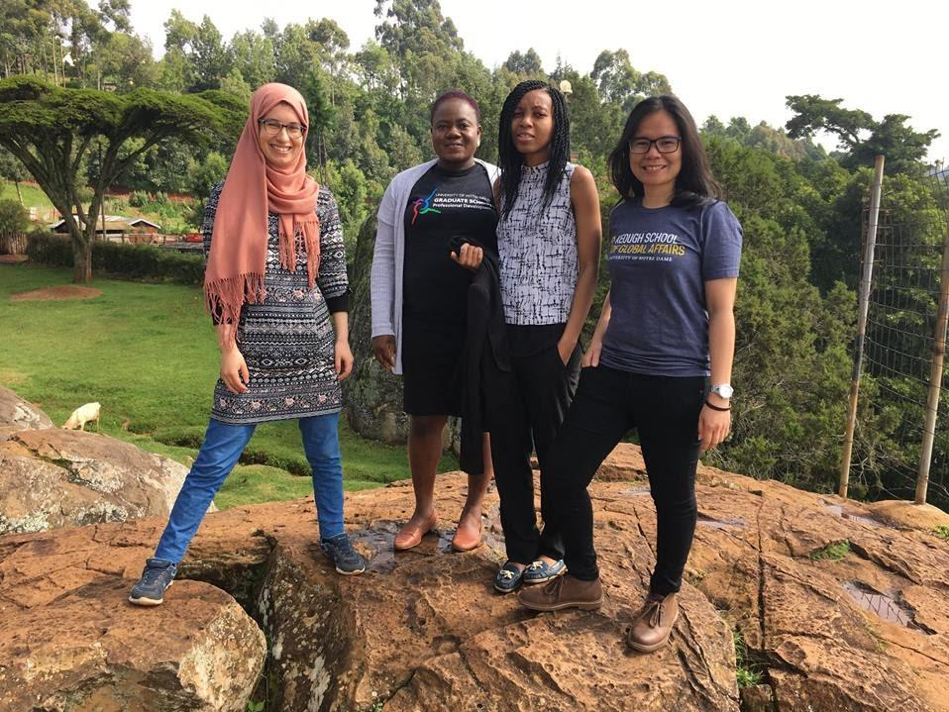 Four MGA students standing on the top of a mountain in Iten, Kenya
