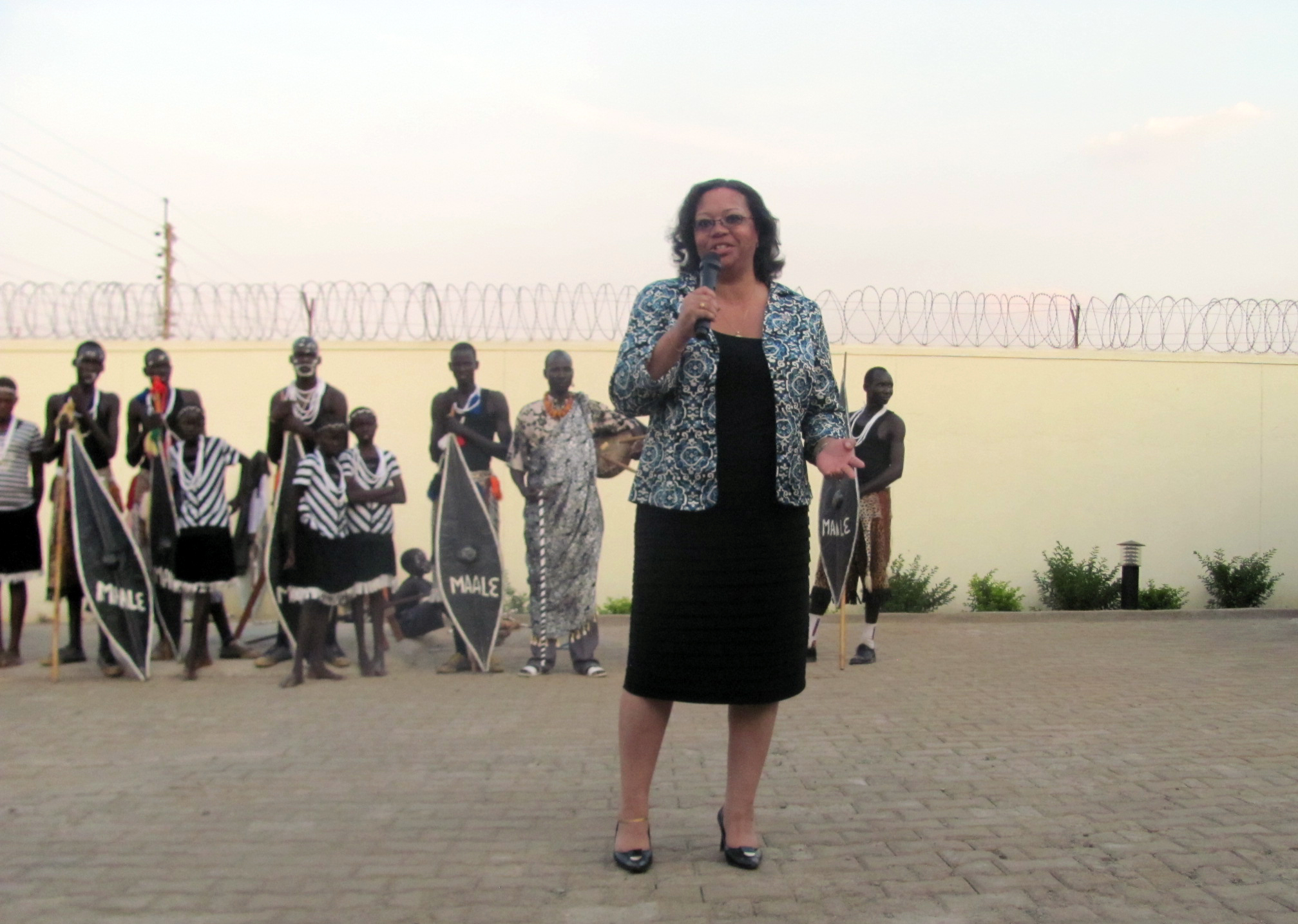 susan page with traditional sudanese dancers