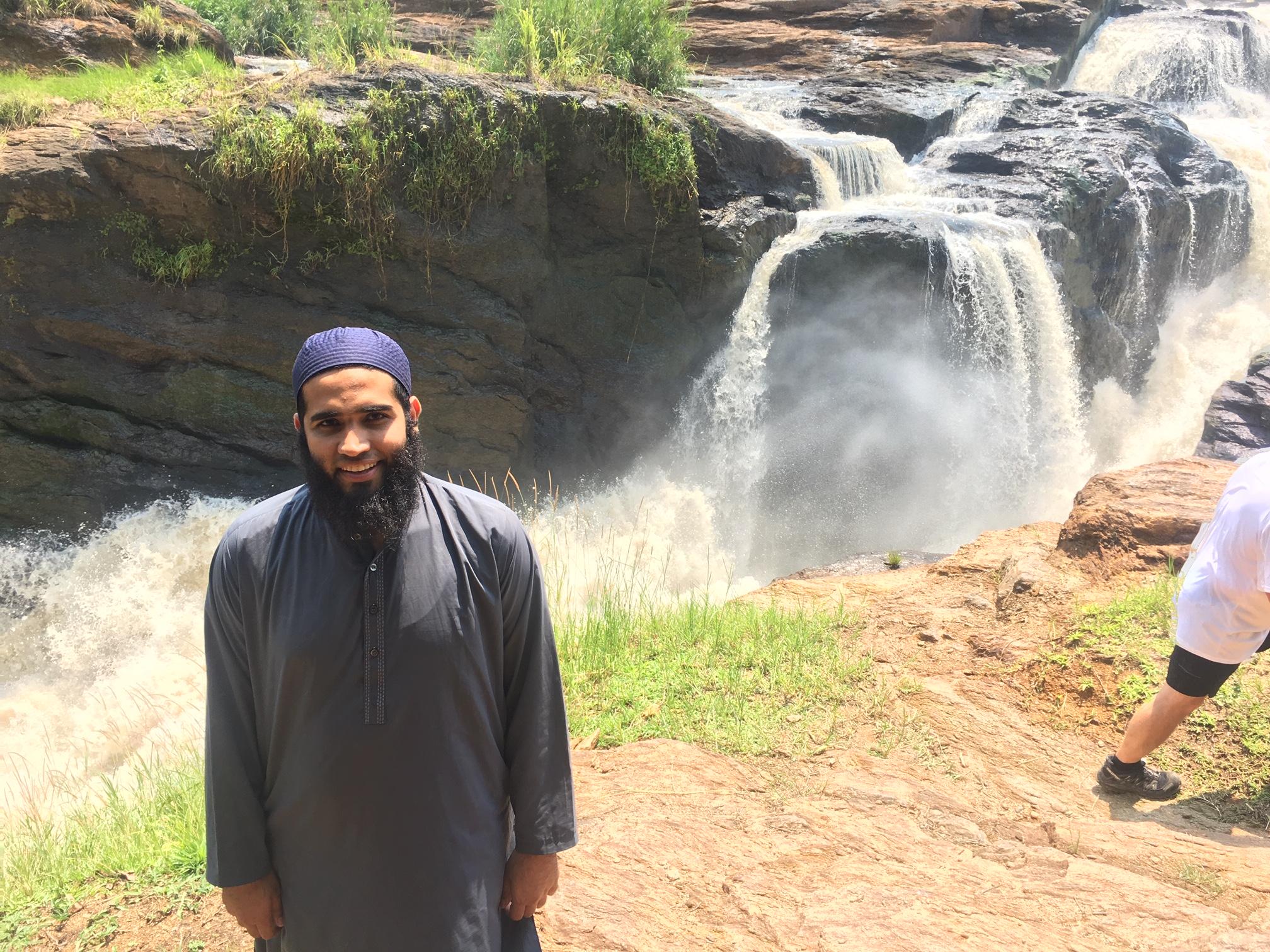 Ahmed Makki at waterfall