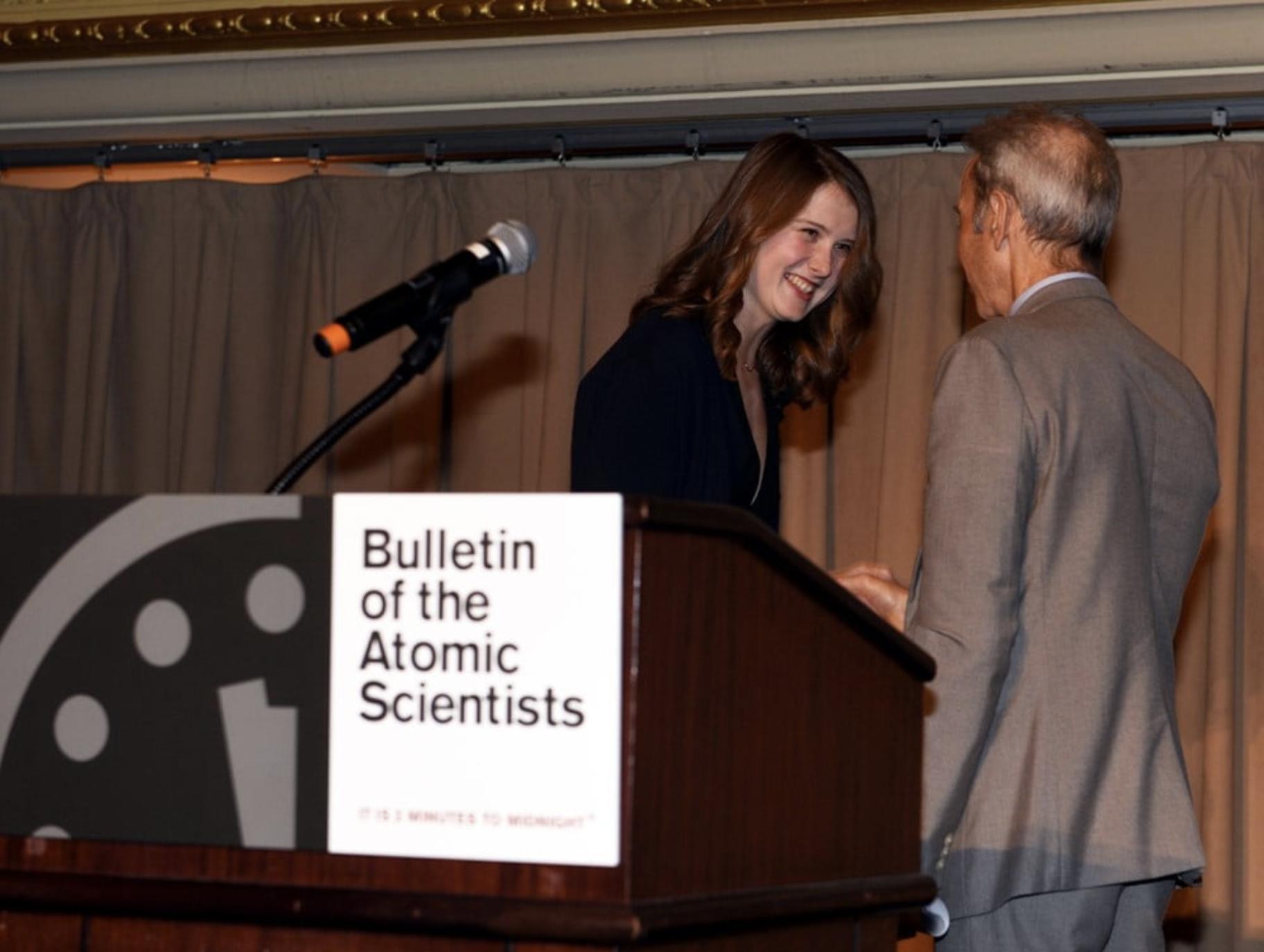 Erin Connolly receiving award