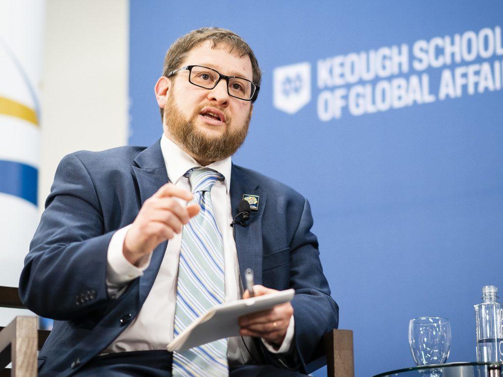 Photo of Keough School professor Joshua Eisenman speaking at a Keough School event in Washington, DC.