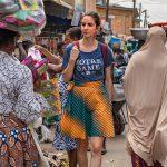 Notre Dame student walks through an outdoor market in Ghana