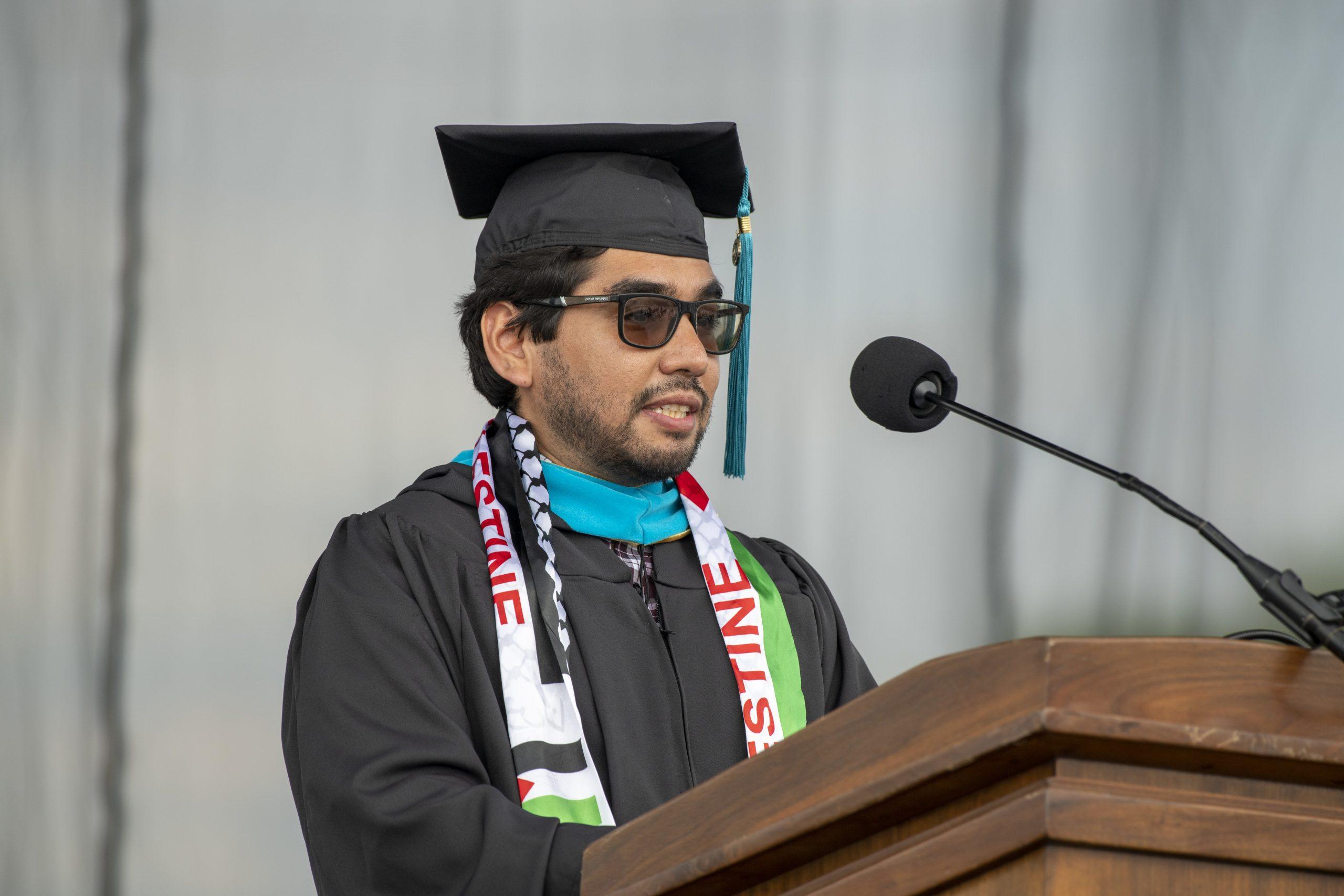 MGA graduate Hugo Flores Navarro addresses the Keough School graduates.