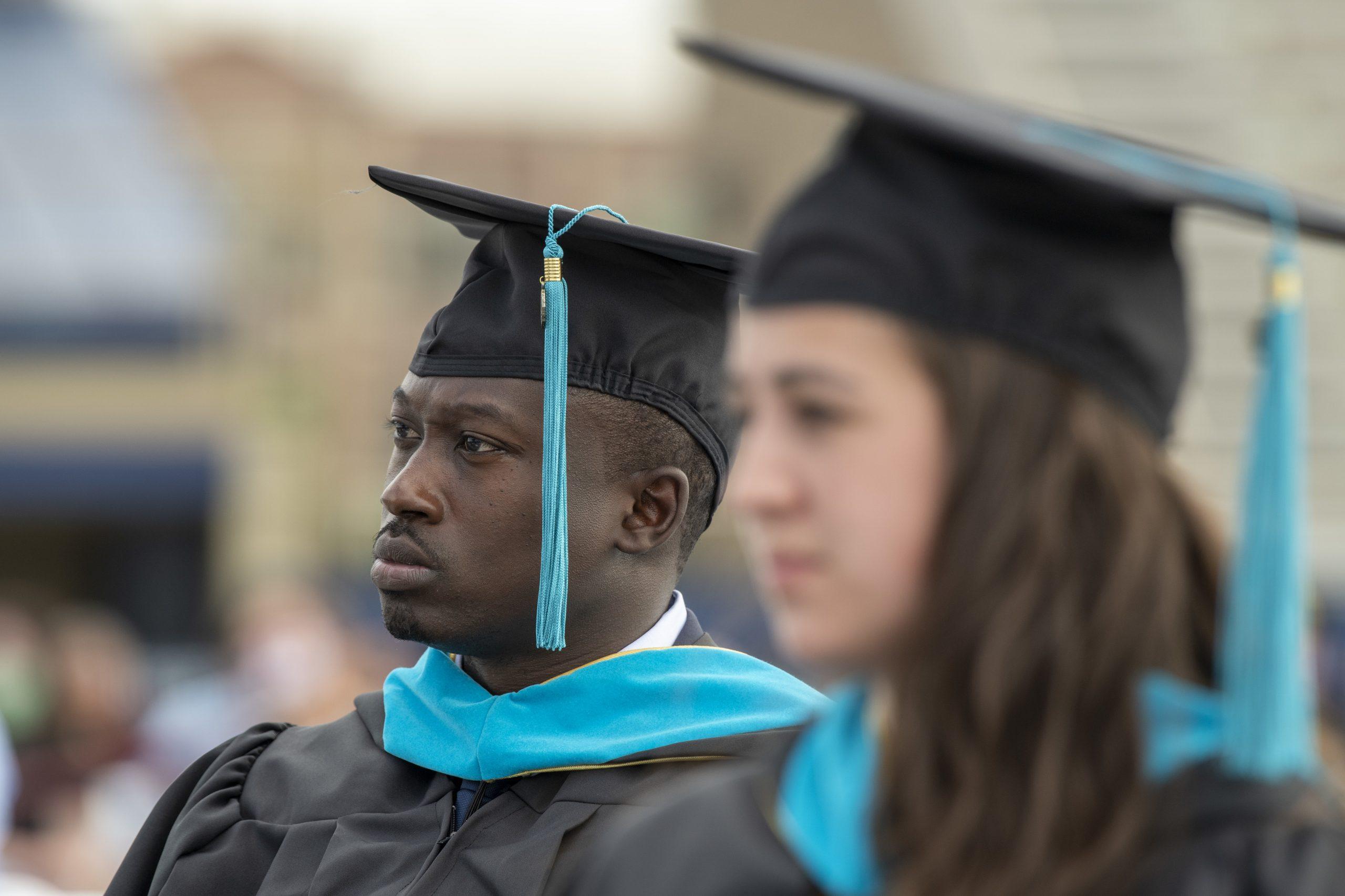 MGA graduates listen to parepared remarks at ceremony.