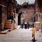 A child runs through a street in Israel
