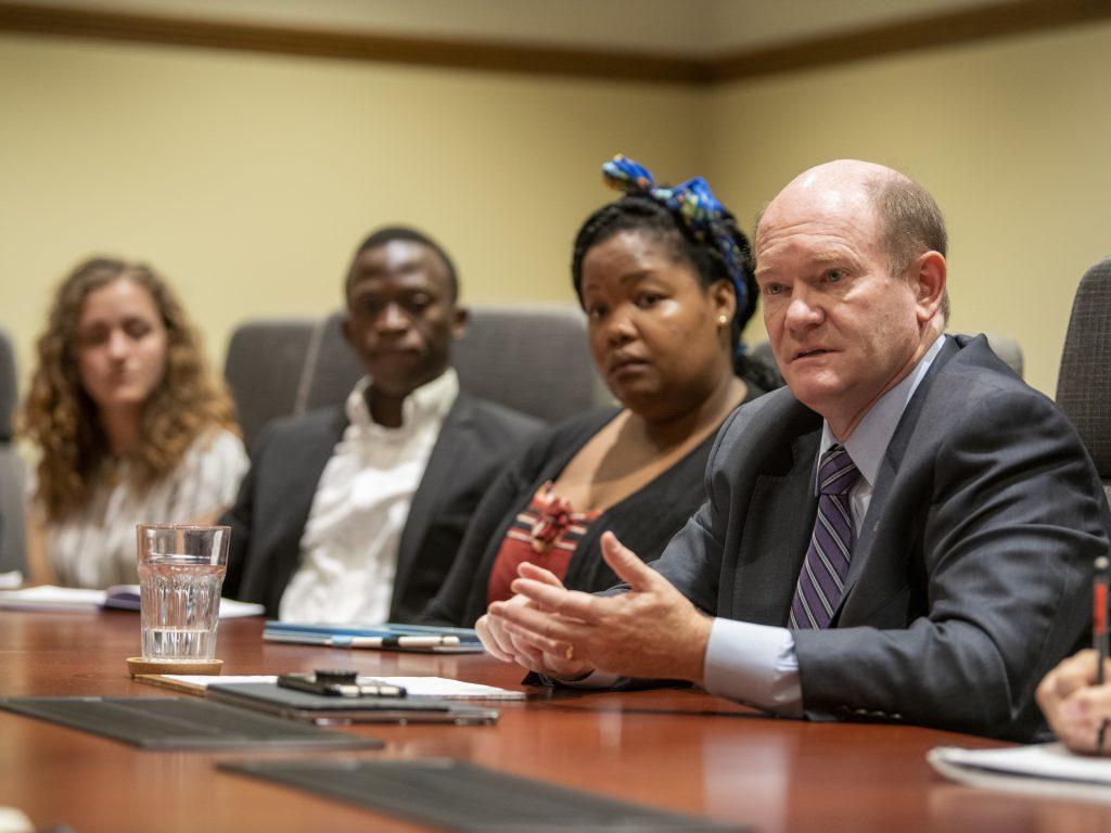 US Senator Chris Coons talking with Notre Dame undergraduates.