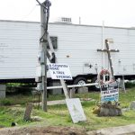 A FEMA trailer surrounded by signs in Louisiana